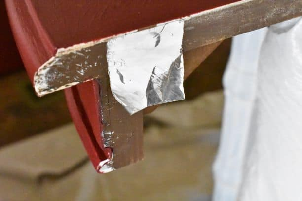 aluminum tape over dowel hole in table