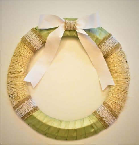 Valentine's Day wreath made of twine, silk ribbon, burlap and lace ribbon, and white grosgrain ribbon