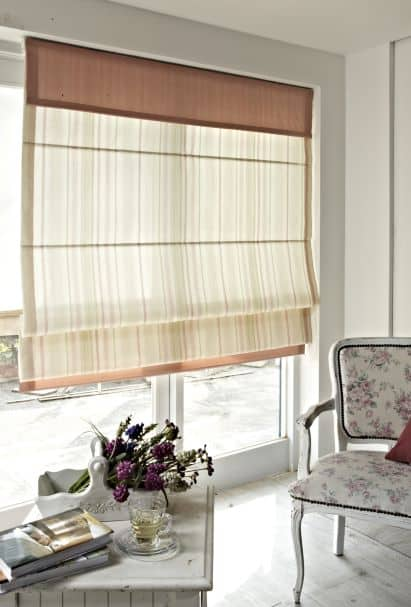 Large window creating illusion of space with sheer covering
