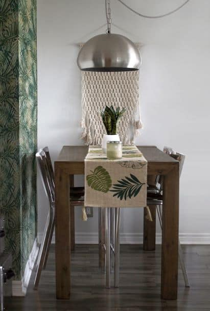 Table and four chairs, large overhead light fixture