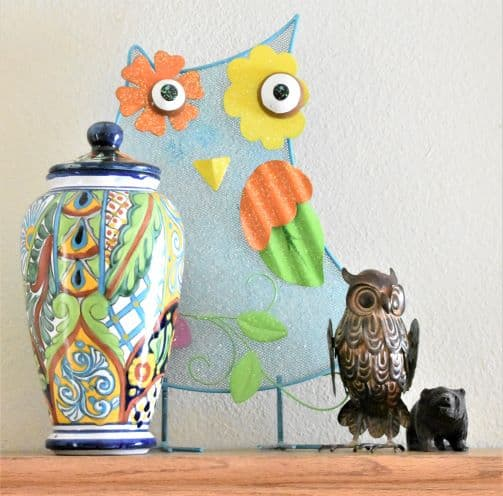 two owl figures, vase, and bear figure