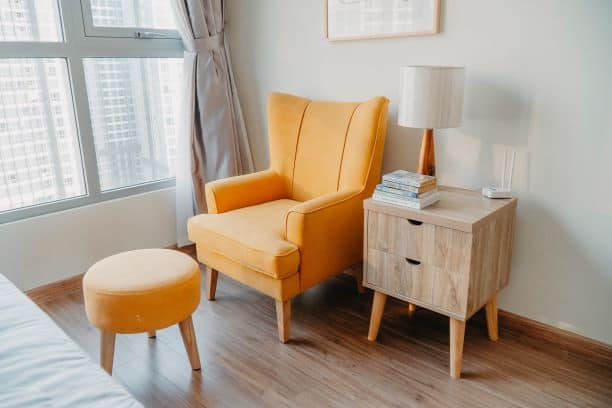 Orange chair and ottoman with side table, mid-century modern
