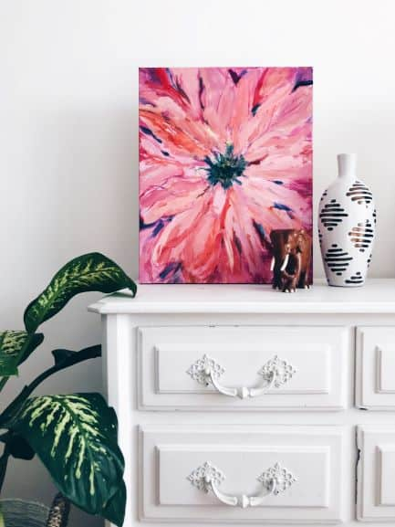 painting on top of dresser with plant beside