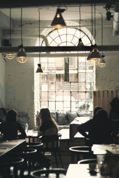 large arched window with people in vintage restaurant