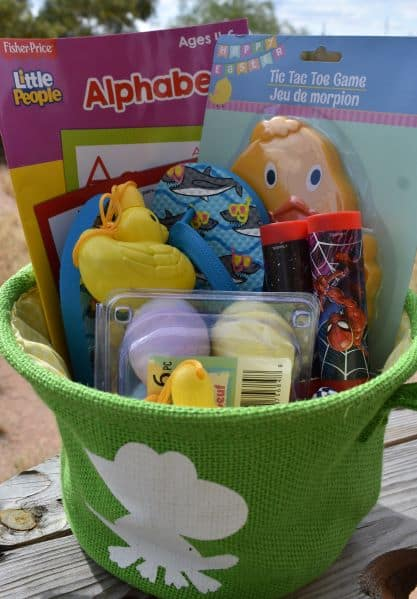 green Easter basket filled with springtime toys