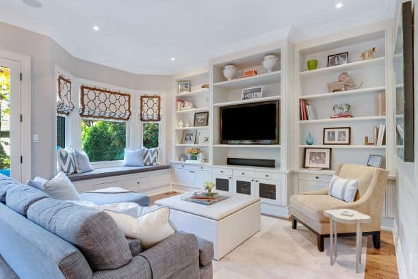horizontal lines of shelves creating movement in interior design in living room with couch, tv, coffee table