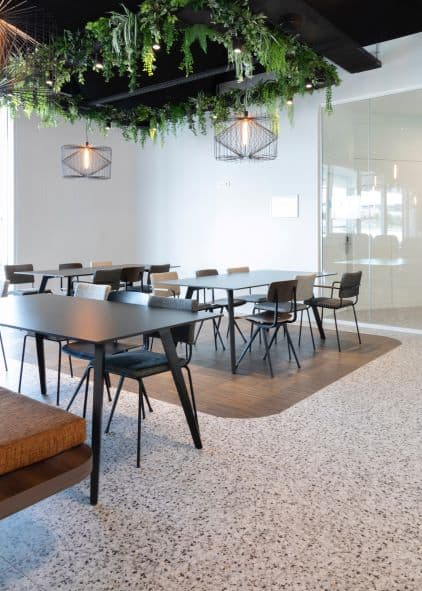 rhythm and emphasis create movement in dining area with interesting plant covered ceiling