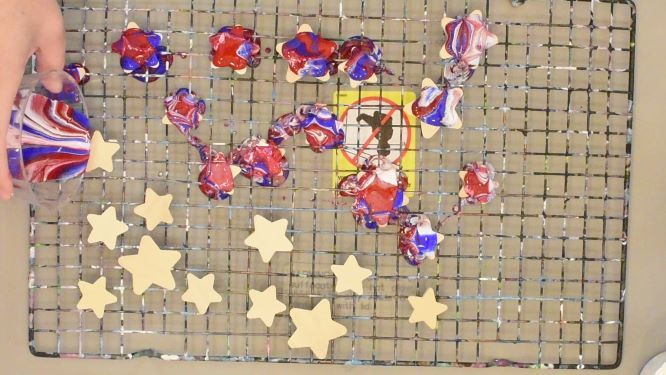 acrylic dirty-cup pour on wooden cutout stars, red, white and blue