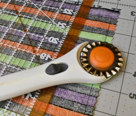 pinking shear disk on rotary fabric cutter