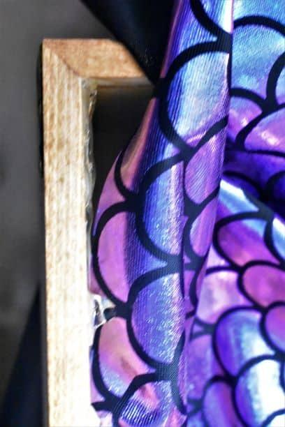 Hot glue fabric lining into treasure chest