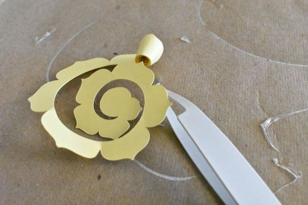 rolling of yellow paper rose with tweezers