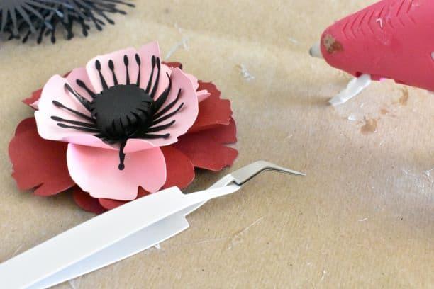 paper poppy, tweezers, glue gun
