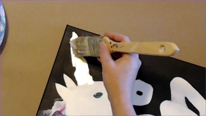 brush off excess gold leaf