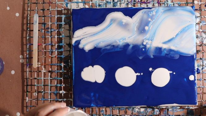 how to paint clouds with acrylic pouring in progress