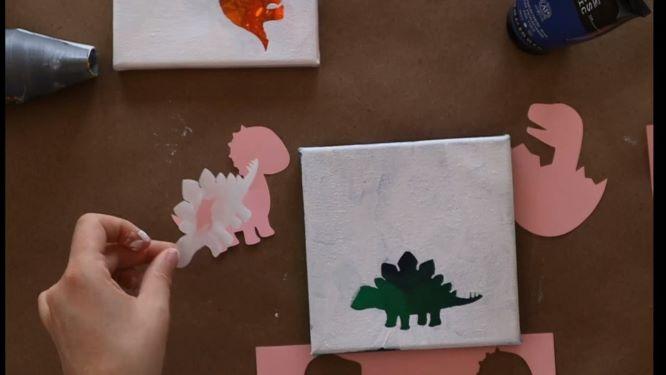 remove dinosaur silhouette template to reveal dinosaur outline