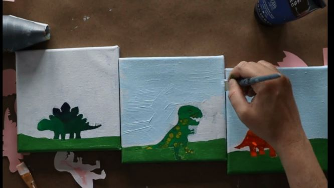painting the sky background in of the dinosaur painting